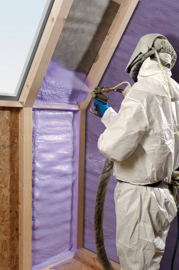Man insulating the walls of a home
