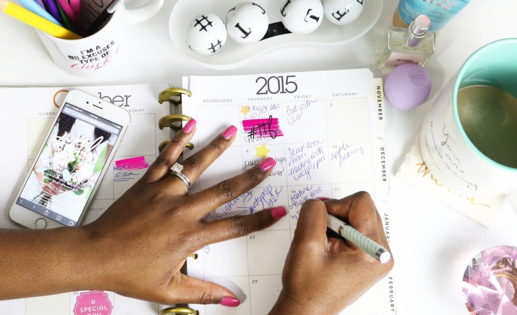 woman writing in her planner
